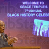 Master of ceremonies: Pastor Michael Russell gives his message during Sunday's 7th Annual Black History Celebration at the Grace Temple.