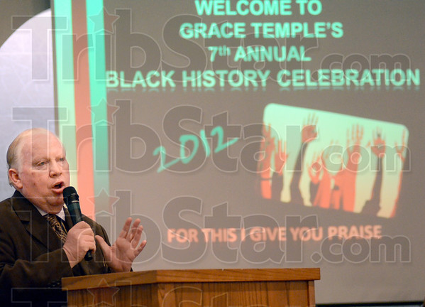 Welcome: Pastor David Fleetwood welcomes those in attendance for the 7th Annual Black History Celebration at the Grace Temple Church Sunday evening.