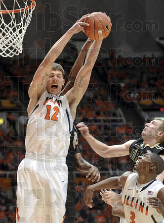 Illinois center Meyers Leonard (12) pulls down a rebound against Purdue forward Robbie Hummel (4) and guard Kelsey Barlow (12), behind Leonard, as Illinois guard Brandon Paul (3) looks on in the second half of an NCAA college basketball game at Assembly Hall in Champaign, Ill., on Wednesday, Feb. 15, 2012. Purdue won 67-62. (AP Photo/Heather Coit)