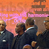 Sing it: A group of ministers sing along the the choir during Sunday's Black History celebration at the Grace Temple Church Sunday evening.