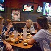 Giants fans: Indiana State University students (from left) Nicole Carson, Lauren Sauley, Sam Richey and Shayli Parr enjoy dinner at BW3's while watching the start of the Super Bowl Sunday evening.