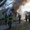 House fire: Terre Haute firefighters arrive at a residence on north 26th Street near 8th Avenue Sunday afternoon.