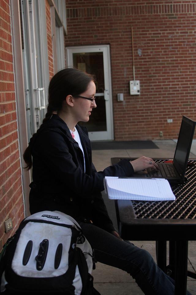 Anna Honea, a GW Student, enjoys the beautiful day on Thursday, February 23rd.