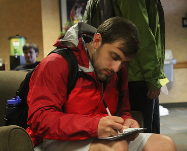 Michael Heredia fills out paperwork during Wednesdays Grad Finale.