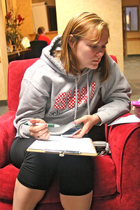 Lesley Warren fills out class ring information at Wednesdays Grad Finale.