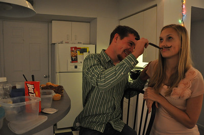 Devan Vanderbark creates a frosting mustache on Mary Hellstrom while hanging out in the University Commons Apartments in Boiling Springs, NC, February 5, 2011.