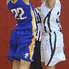 Tribune-Star/Jim Avelis<br /> Stuffed eagle: West Vigo forward Erin Barton blocks a shot by Brown County's Sasha Robinson in first half action of their sectional matchup Friday night in Spencer.