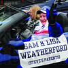 Mom and Pop: Steve Weatherford's parents Sam and Lisa cruise along Wabash Avenue during Friday's parade honoring their son.