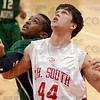 Locked: South's #44, Lucas Steward is locked in battle with an Evansville North player as they look to rebound a missed free throw Friday evening.