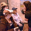 Picture this: Barbara Ater, Jennifer Roth and Melissa Turner check the photograph taken by Tiffany Heng at Java Haute Friday evening as part of a fundraising event.