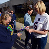 Tribune-Star/Joseph C. Garza<br /> Sharing Super Bowl fun: Vigo County School Corporation bus driver Patty Love receives a stack of signed photos of New York Giants punter Steve Weatherford from Weatherford's mother and fellow bus driver, Lisa Weatherford, Friday at Lost Creek Elementary School.