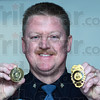 Tribune-Star/Jim Avelis<br /> Souvenirs: Indiana State police Sgt. Joe Watts holds his Super Bowl XLVI badge and challenge coin.