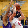 Strong: South's #44, Lucas Steward takes the  ball strong to the basket against a Ben Davis player Friday night.