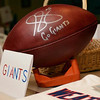 Tribune-Star/Joseph C. Garza<br /> Signed by No. 5: A ball signed by New York Giants punter Steve Weatherford sits on display with notes from students Friday at Lost Creek Elementary School.