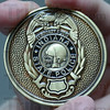 Tribune-Star/Jim Avelis<br /> Keepsake: Challenge coins like this one for eh Indiana State police were made for several different emergency responder organizations, commemorating their efforts around Super Bowl XLVI.