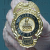 Tribune-Star/Jim Avelis<br /> For those who serve: Badges for state police officers were specially made to commemorate Super Bowl XLVI.