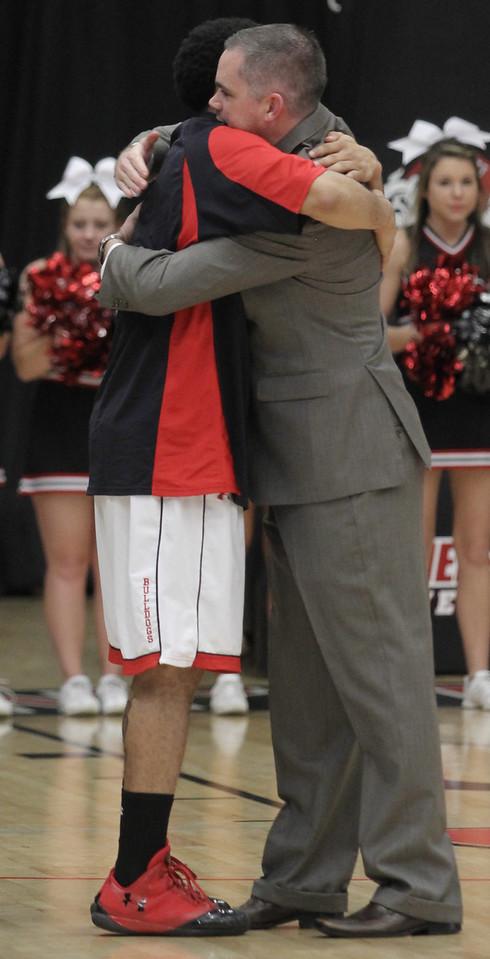 Senior Laron Buggs gives Coach Holtmann a hug during pre-game senior recognition