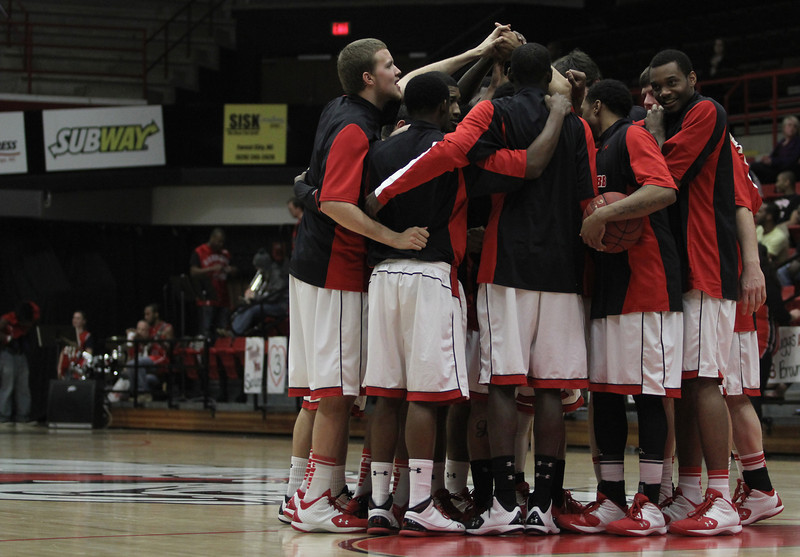 The Runnin' Bulldogs huddle up during warm ups