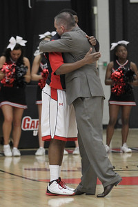 Senior David Brown gives Coach Holtmann a hug during pre-game senior recognition