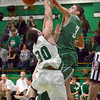 Rejection: North Central's #3, Aaron Bellgraph rejects the shot of West Vigo forward Cody Thornton during first half action Saturday night.