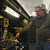 Tribune-Star/Jim Avelis<br /> Inner workings: Mike Egy, of RYO Cheap Smokes, talks about the mechanics of the machine that inserts the tobacco into the paper tubes.