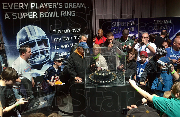Tribune-Star/Joseph C. Garza<br /> Winner's ring: Fans take photos and look over the Super Bowl ring display Sunday, Jan. 29, at the NFL Experience presented by GMC in Indianapolis.