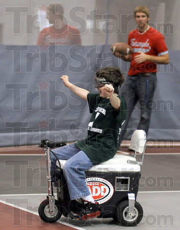 Celebrate: David Herrick of West Vigo middle school celebrates finishing the obstacle course without crushing any cones during Saturday's SADD games at Rose-Hulman.