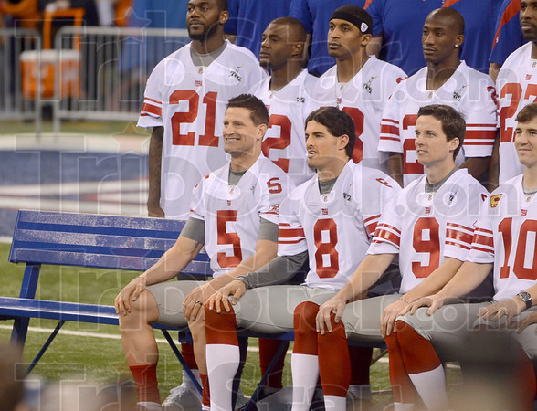 Tribune-Star/Joseph C. Garza<br /> Say cheese, Steve: New York punter and former Terre Haute North standout Steve Weatherford (5) smiles for the New York Giants' Super Bowl team photo Tuesday, Jan. 31 at Lucas Oil Stadium.