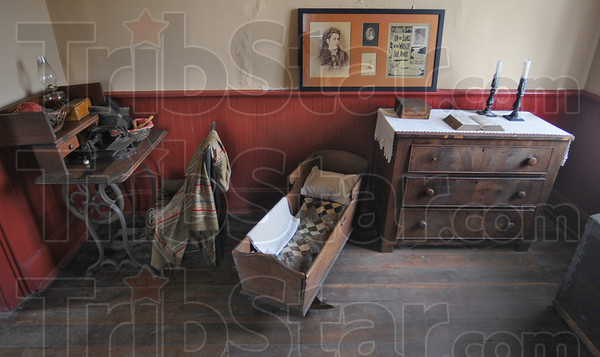 Tribune-Star/Jim Avelis<br /> Period look: Part of the furnishings of the Paul Dresser home are a treadle sewing machine, cradle and chest of drawers.