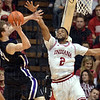 Hard to shoot over: Indiana's Christian Watford tries to block a shot by Northwestern's John Shurna during the Hoosiers' game against the Wildcats Wednesday at Assembly Hall in Bloomington.