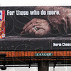 Tribune-Star/Jim Avelis<br /> Visible: A billboard along south 3rd street in the Kroger South parking lot features local electrician Norm Cheesman's hands in an ad for Dinty Moore beef stew.