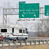 "Tribune-Star/Joseph C. Garza<br /> The exit formerly known as U.S. 40: A motorist on I-70 drives east Wednesday under the Exit 1 sign that once contained ""U.S. 40 East"" on it to notify drivers that they could take that exit to enter onto U.S. 40."