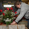 Tribune-Star/Jim Avelis<br /> On the move: Debbie Cagle loads her delivery van, getting ready to deliver bouquets to customers of Cowan & Cook Florists.