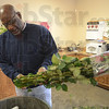 Tribune-Star/Jim Avelis<br /> Snip: Curtis Lyle prepares roses for his designers to arrange into bouquets at Cowan & Cook Florist.