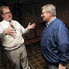 Tribune-Star/Joseph C. Garza<br /> Campaign planning: James Mann, candidate for Indiana House District 46, talks with retired teacher, Stephen Moore, after a campaign meeting Monday at the Holiday Inn.