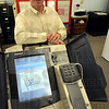 Tribune-Star/Jim Avelis<br /> Welcome: Edgar County clerk August Griffin stands by the electronic voting machine in the absentee voter's room in the courthouse. Early voting is now going on in Illinois.