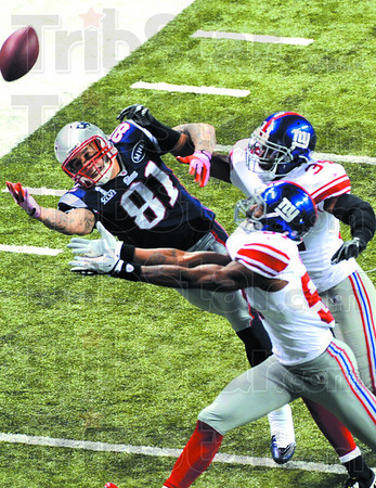 New England's Aaron Hernandez can't make the catch as he is covered by two New York Giant defenders SundayNduring the Super Bowl XLVI in Indianapolis.