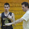 Tribune-Star/Jim Avelis<br /> Instructions: Tyler Talpas listens to his coach, Dugger head basketball coach Chip langley during a practice session last week.