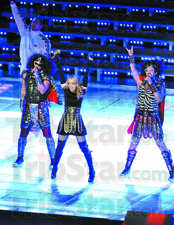 Madonna performs with the members of LMFAO during the halftime show of Super Bowl XLVI Sunday, Feb. 5, 2012 in Indianapolis. (Photo by Joseph C. Garza/Tribune-Star)