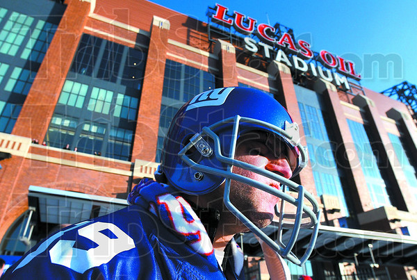 A New York Giants fan wearing a team helmet enters Lucas Oil Stadium in Indianapolis, Sunday for Super Bowl XLVI.