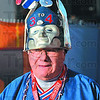 "New England Patriots fan Jack ""Bo"" Kenendy of Andover, Mass., wears decorative head wear as he walks towards Lucas Oil Stadium for Super Bowl XLVI Sunday in Indianapolis."
