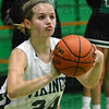 Tribune-Star/Jim Avelis<br /> From the corner: West Vigo guard Charity Lane looks for three of her first half points.