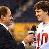 ESPN's Chris Berman interviews New York Giants quarterback Eli Manning during Media Day Tuesday, Jan. 31, 2012 in Indianapolis. (Photo by Joseph C. Garza/Tribune-Star)