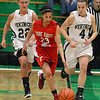 Tribune-Star/Jim Avelis<br /> On the run: Terre Haute South's Labrea Joyner heads up court with Vikings Mikaela Silcock(22) and McKenzie Little(4) in tow.