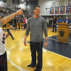 Tribune-Star/Jim Avelis<br /> P-A-T-R-I-O-T-S: Terre Haute principal Stacey Mason leads the school assembly in a cheer from New York Giants punter Steve Weatherford at an all-school assembly Tuesday afternoon.
