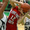 Tribune-Star/Jim Avelis<br /> Shooting two: Terre Haute South's Tasia Brewer is fouled during a shot attempt. Defending on the play are West Vigo center Erin Barton and guard Charity Lane.