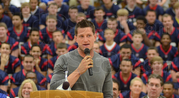 Tribune-Star/Jim Avelis<br /> Back home: New York Giants punter and Terre Haute native Steve Weatherford addresses an assembly at Terre Haute North Tuesday afternoon. He brought teammates Zak DeOssie and Lawrence Tynes with him.