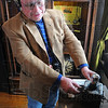 Tribune-Star/Jim Avelis<br /> Tuned in: Mark Day dons the headset for his Crosley Pup radio that is on display at the Vigo County Historical Museum.
