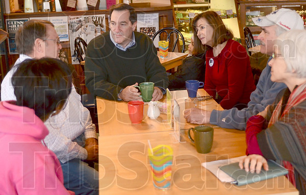 Tribune-Star/Joseph C. Garza<br /> Listening to voters: Democratic candidate for the U.S. Senate, Joe Donnelly, center, listens as David Hartmann, left, talks about farming during a campaign stop Tuesday morning at Boo's Crossroads Cafe.