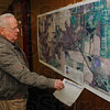 Tribune-Star/Jim Avelis<br /> Interested party: Lowell Eck of Youngstown, looks over the aerial photos of the route the 641 bypass will take where Riley rRad and Indiana 46 meet. Two roundabouts will be a part of the traffic flow helping travelers get where they are going.